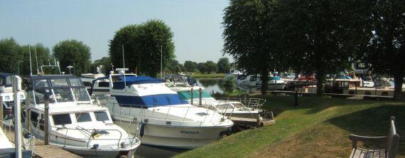 Boats moored up at Newark Marina on a sunny summer day.