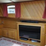 Wide Beam Barge - Large digital TV with speakers and satelite dish