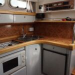 Sealine S28 - Galley with gas hob, oven, fridge and sink unit