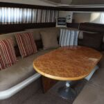 Sealine S28 - Large dining table and seating which converts into a double berth