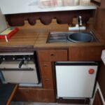 Fairline Mirage - Galley comprises of gas hob, grill, oven, fridge and stainless steel sink with mixer tap